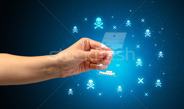 Stock photo: Handing over pills with skulls