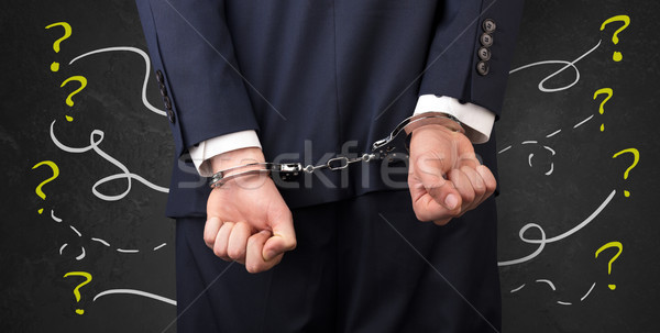 Close prisoner hand with questions around Stock photo © ra2studio