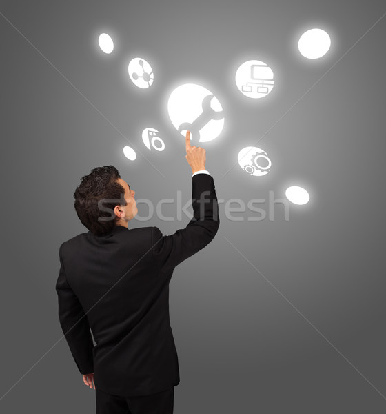 business man pressing touchscreen button  Stock photo © ra2studio