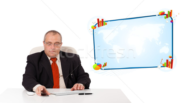 businessman sitting at desk and holding a mobilephone, isolated on white Stock photo © ra2studio