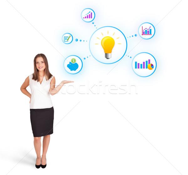 Młoda kobieta żarówka kolorowy odizolowany Zdjęcia stock © ra2studio