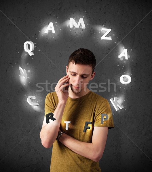 Young man thinking with letter circulation around his head Stock photo © ra2studio