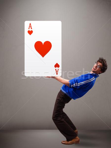 Jeune homme rouge coeur ace séduisant Photo stock © ra2studio