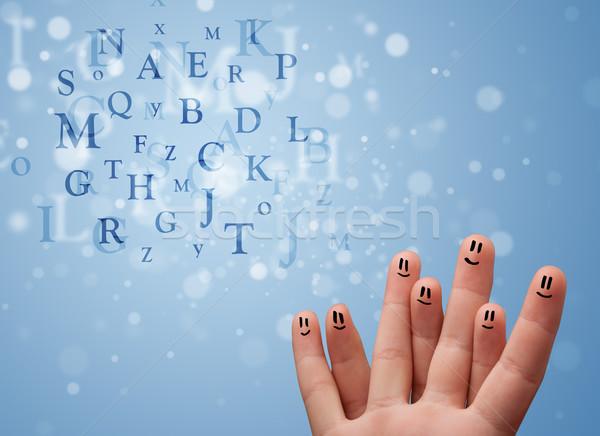 Feliz emoticon dedos olhando mistura bokeh Foto stock © ra2studio
