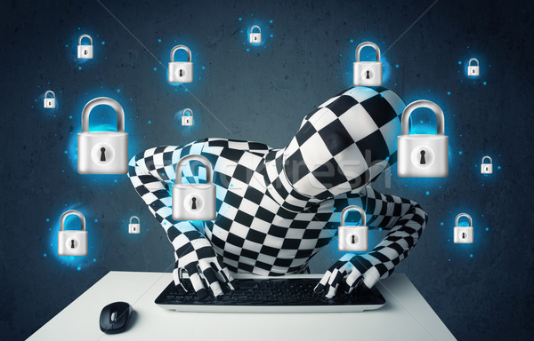 Hacker in disguise with virtual lock symbols and icons Stock photo © ra2studio