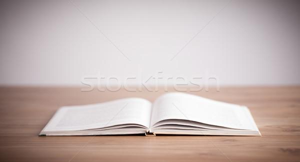 Open Book on wood background Stock photo © ra2studio