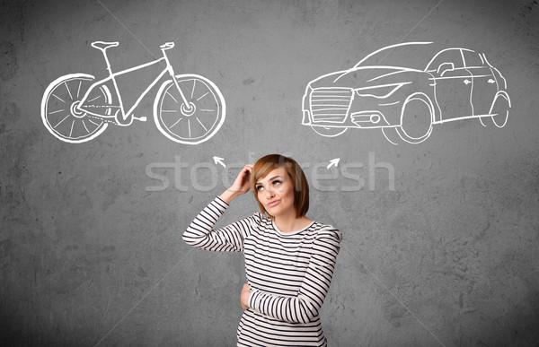 Woman making a choice between bicycle and car Stock photo © ra2studio