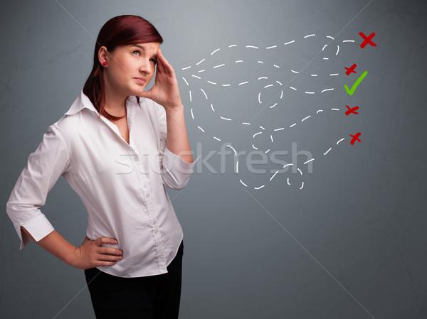 Young woman choosing between right and wrong signs Stock photo © ra2studio