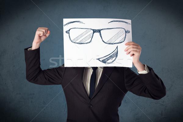 Empresário papel rosto sorridente jovem cabeça Foto stock © ra2studio