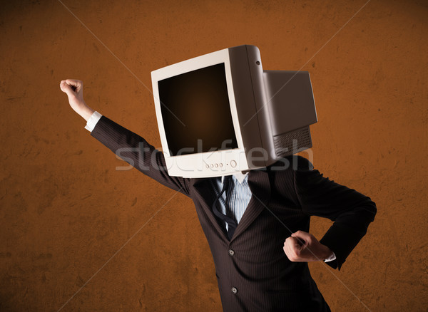 Business man with a monitor on his head and brown empty space Stock photo © ra2studio
