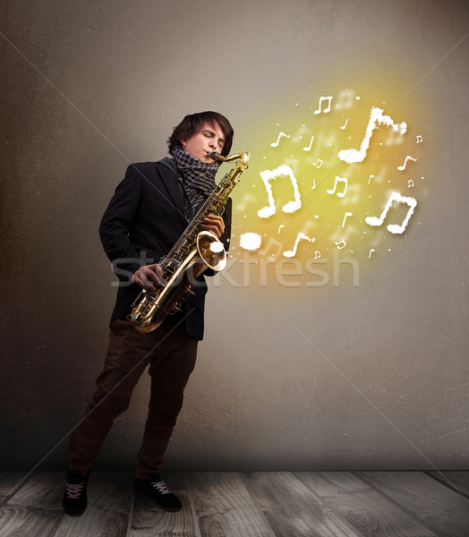 ハンサム ミュージシャン 演奏 サクソフォン 音符 小さな ストックフォト © ra2studio