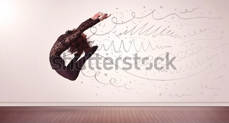 Stock photo: Pretty woman jumping with hand drawn lines and arrows come out