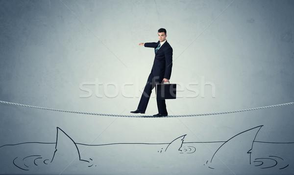Empresário caminhada corda acima corajoso Foto stock © ra2studio