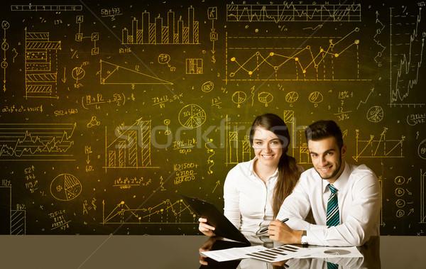 Business paar diagram vergadering zwarte tabel Stockfoto © ra2studio