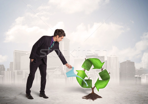 Business man watering green recycle sign tree on city background Stock photo © ra2studio