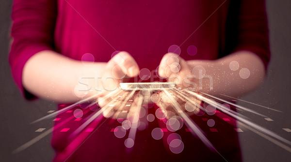 Személy tart technológia fény applikációk nő Stock fotó © ra2studio
