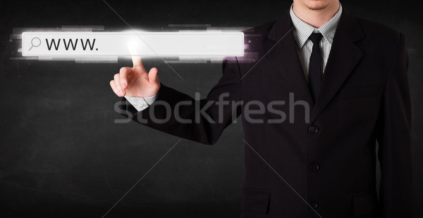Genç işadamı dokunmak web tarayıcı adres Stok fotoğraf © ra2studio