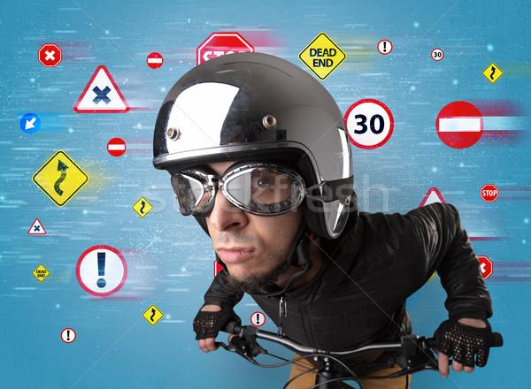 Stylish biker with highway code concept Stock photo © ra2studio