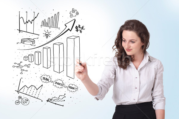 Jóvenes mujer de negocios dibujo diagramas Foto stock © ra2studio