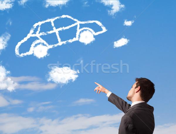 Bonito moço olhando carro nuvem blue sky Foto stock © ra2studio