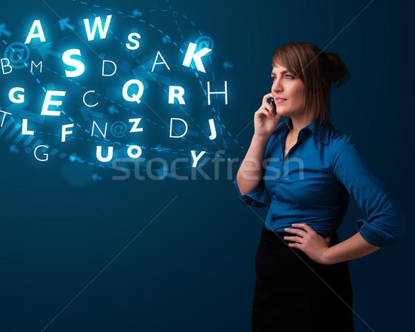 Fiatal hölgy készít telefonbeszélgetés fényes betűk Stock fotó © ra2studio