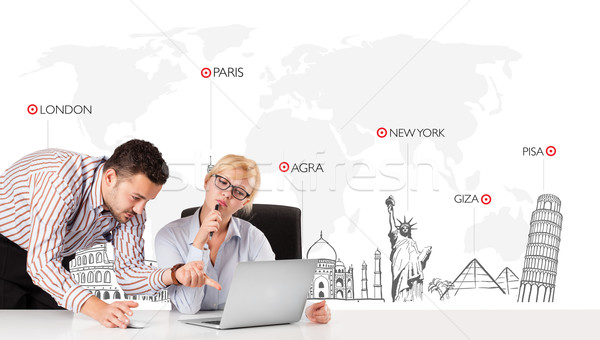 Young businessman and businesswoman with world map and major landmarks of the world Stock photo © ra2studio
