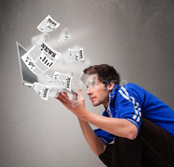 若い男 ノートパソコン 読む 爆発的 ニュース ストックフォト © ra2studio