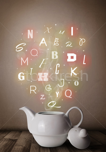 Tea pot with colorful letters Stock photo © ra2studio