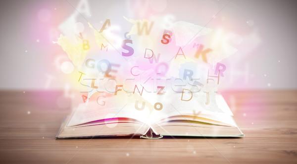 Foto d'archivio: Libro · aperto · lettere · concrete · colorato · istruzione