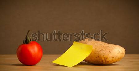 Potato with post-it note looking at tomato Stock photo © ra2studio