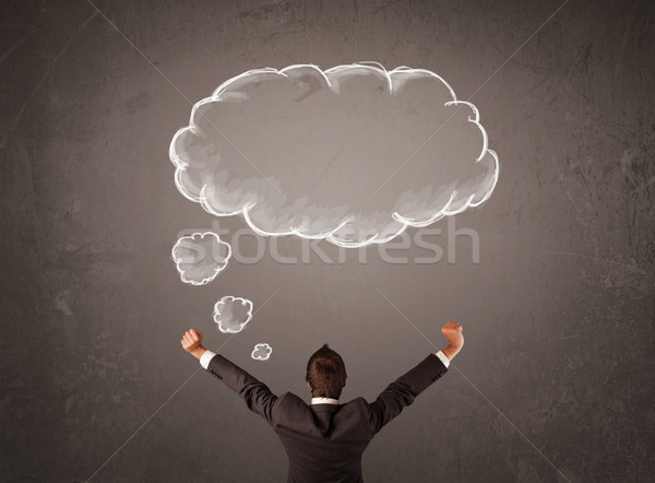 Businessman with cloud thought above his head Stock photo © ra2studio