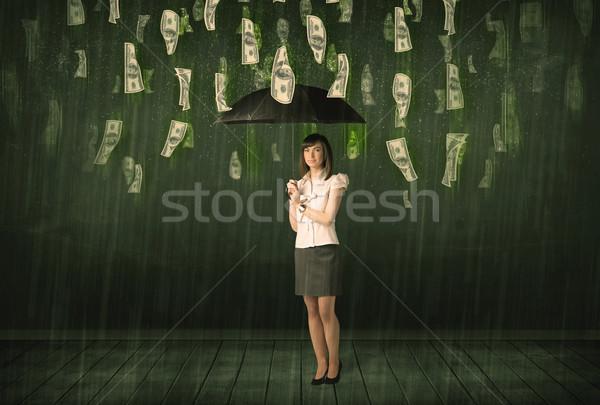 Zakenvrouw permanente paraplu dollar Bill regen Stockfoto © ra2studio