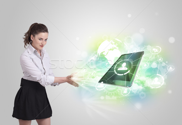 Business girl showing modern tablet technology concept Stock photo © ra2studio