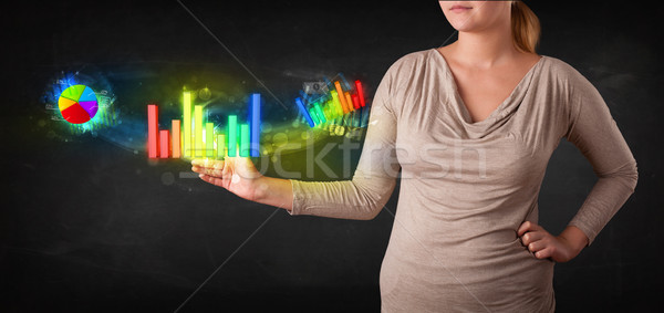 Young businesswoman touching colorful modern graph system concep Stock photo © ra2studio