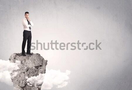 Businessman on rock mountain Stock photo © ra2studio