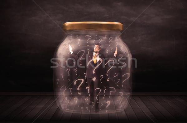 Foto stock: Empresário · trancado · jarra · pontos · de · interrogação · negócio · vidro