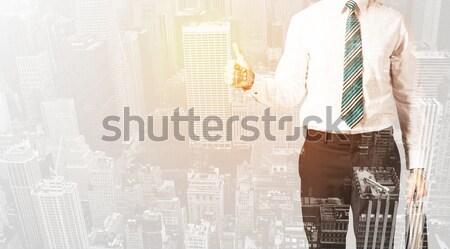 Homem de negócios olhando cidade quente céu escritório Foto stock © ra2studio