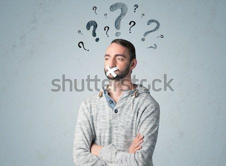 молодым человеком рот вопросительный знак вокруг голову Сток-фото © ra2studio