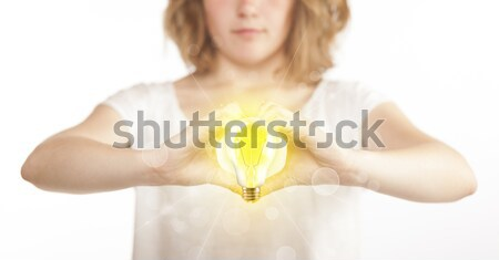 Hands creating a form with light bulb Stock photo © ra2studio