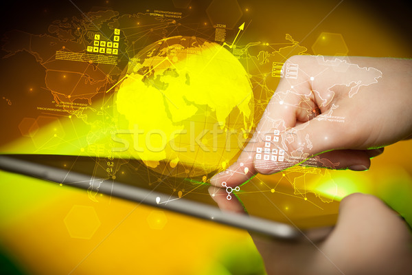 Hand touching tablet with global estate report concept Stock photo © ra2studio