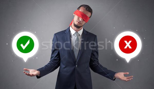 Bekötött szemű üzletember választ osztályzat fölött kéz Stock fotó © ra2studio
