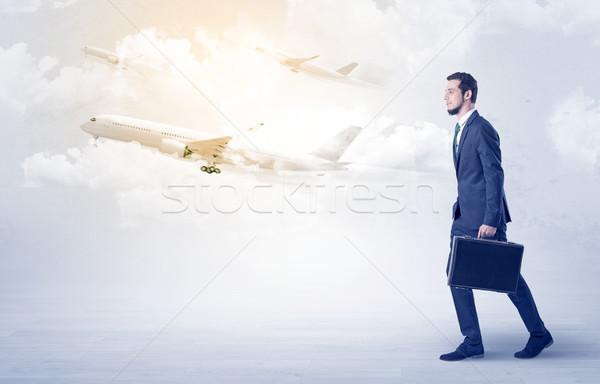 Businessman going somewhere with airplane Stock photo © ra2studio