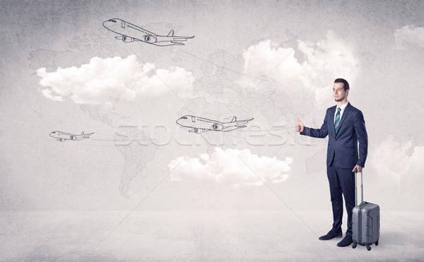 Businessman hitchhiking with airplanes around Stock photo © ra2studio