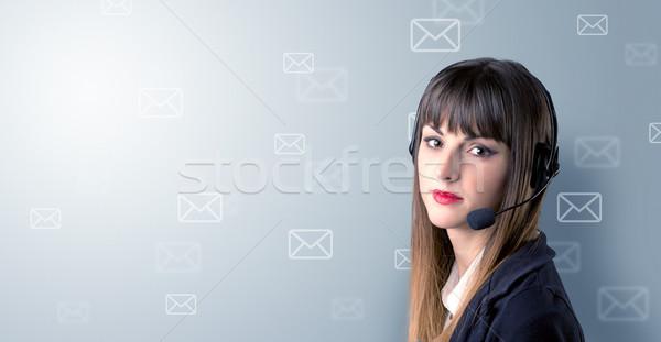 Female telemarketer concept Stock photo © ra2studio