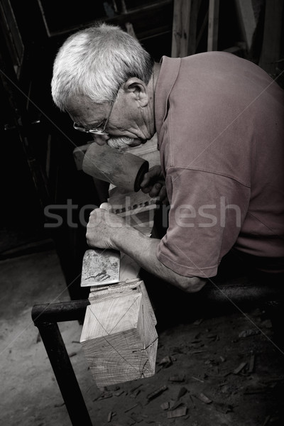 woodcarver working with mallet and chiesel  Stock photo © ra2studio