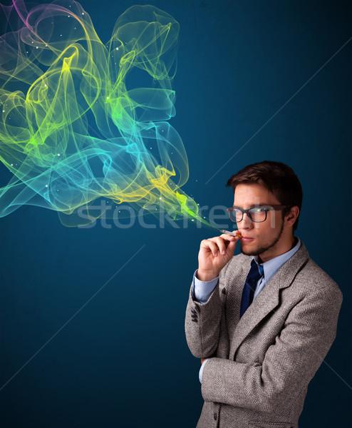 Hombre guapo fumar cigarrillo colorido humo guapo Foto stock © ra2studio