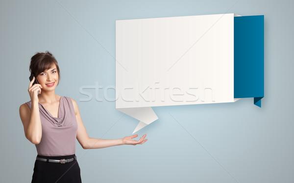 Dość młoda kobieta stałego nowoczesne origami kopia przestrzeń Zdjęcia stock © ra2studio