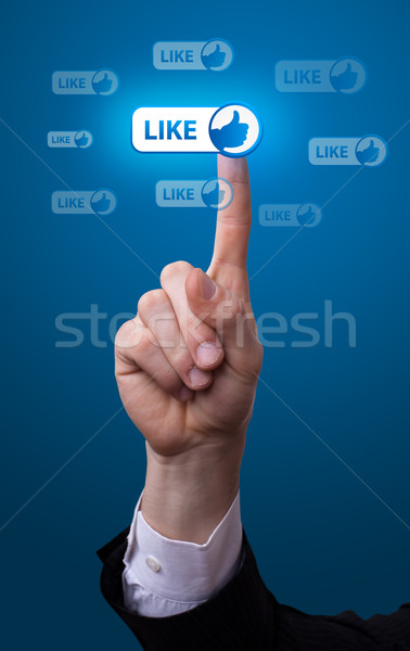 hand pressing like button Stock photo © ra2studio