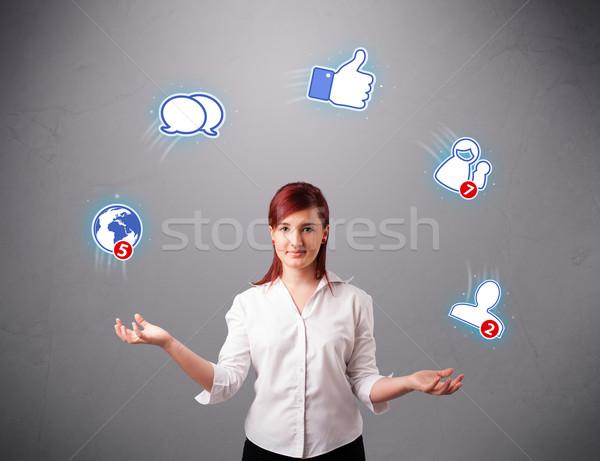 Aantrekkelijk jonge vrouw jongleren iconen permanente Stockfoto © ra2studio