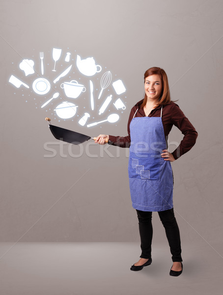 Young woman with kitchen accessories icons Stock photo © ra2studio